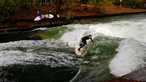 german surfer rides riverbreak munich